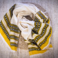 Milk light scarf with golden-yellow ornament