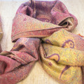 Pink and gold stole with oriental ornaments