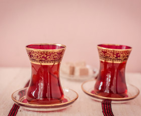 Turkish red tea glass with a saucer